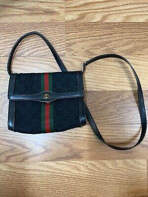 Authentic vintage Gucci Black GG Strap Clutch Shoulder Bag