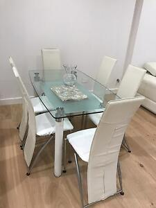 Glass square dining table with 6 chairs quick sale Ryde Area Preview