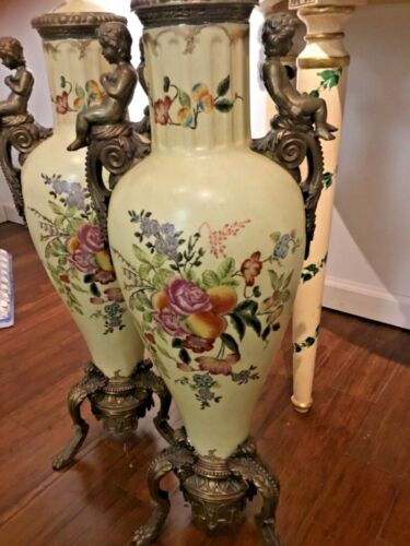 Pair of hand painted vases with bronze mounts