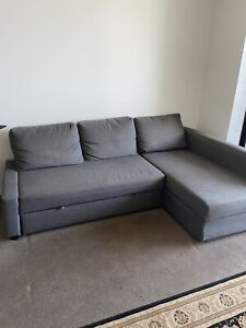 Three seater sofa bed with storage compartment