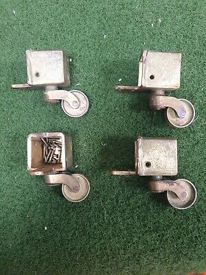 VINTAGE 4 BRASS FURNITURE LION CLAW FOOT SWIVEL CASTERS.
