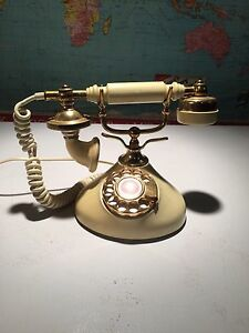 Vintage phone. Very French boudoir.