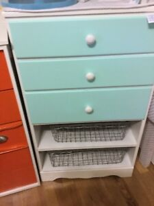 Blue and white small dresser with baskets-