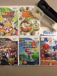 6 Nintendo Wii Games + Attachments