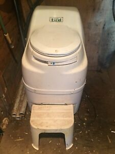 Composting toilet and foot pump sink