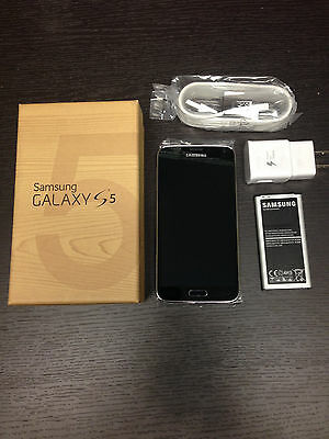 New In Box Samsung Galaxy S5 SM-G900T Black T-Mobile Smartphone
