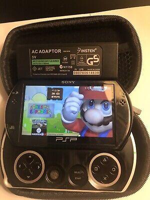 PSP GO 32GB BUNDLE 7200GAMES!! & RARE 16gb M2 Card + 40 LARGER PSP GAMES WWE2K18