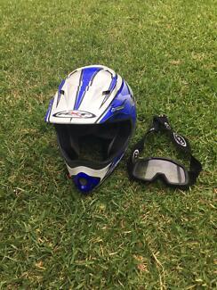 Kid's RXT medium motorbike helmet and goggles
