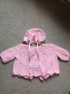 Beautiful hand knit baby clothes