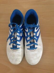 White and blue Adidas soccer shoes size 4