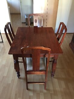 Black Glass dining table and wooden chairs Dining Tables