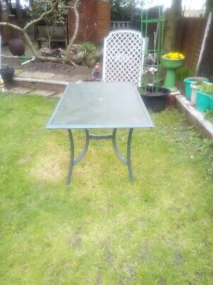 Glass topped heavy duty, 6 Seater table, with hole for Parasol