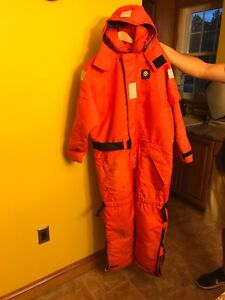 Anti exposure flotation suit