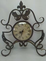 Western Hemisphere mantle clock wrought iron decorative scrolled roman numerals