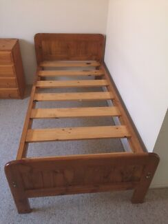 2 wooden single bed frames with matching drawers