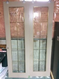 2 sliding doors with glass panel