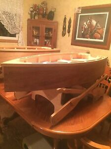 Dori  boat coffee table with glass top 750obo