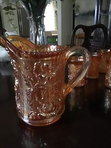 Amber carnival glass pitcher with matching glasses