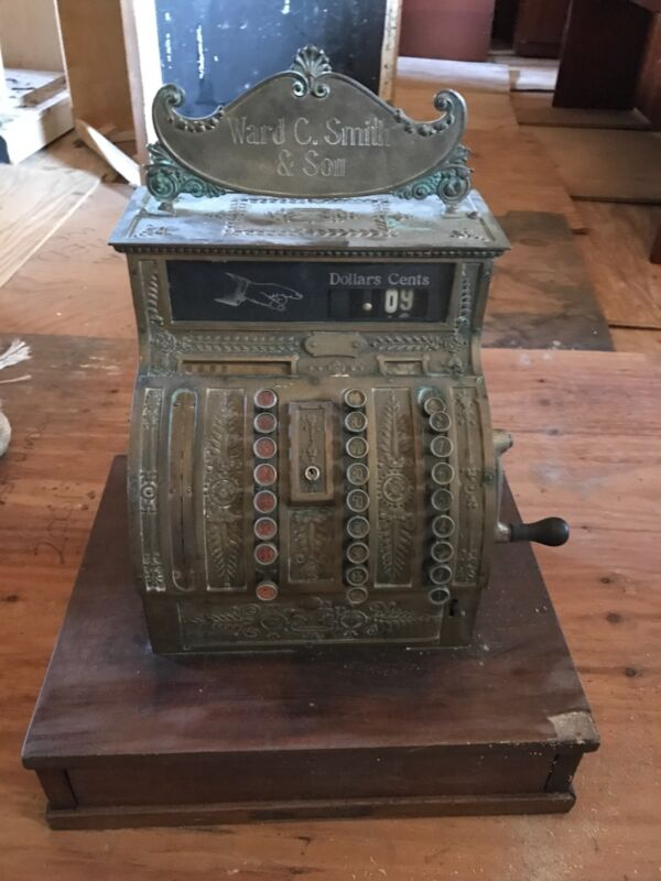 antique brass cash register