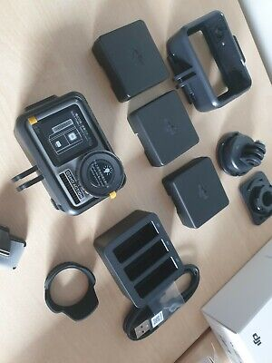 DJI Osmo Action Camera boxed with unused accessories and spare battery
