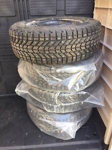 15 inch Firestone Winterforce tires (4) on rims Toyota Camry