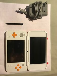 2DS Xl with Mario kart 7 and Super Smash Bros