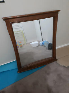 Mirror with a solid wood frame