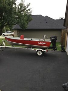 14ft Lund Boat with 2 Stroke 25 HP Mercury Motor