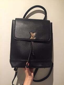 84a1571419272f LV lockme backpack (black with gold details).  100. Chapel Hill