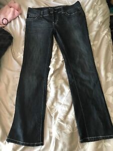 2 Mid rise boot cut guess jeans size 31 and 29