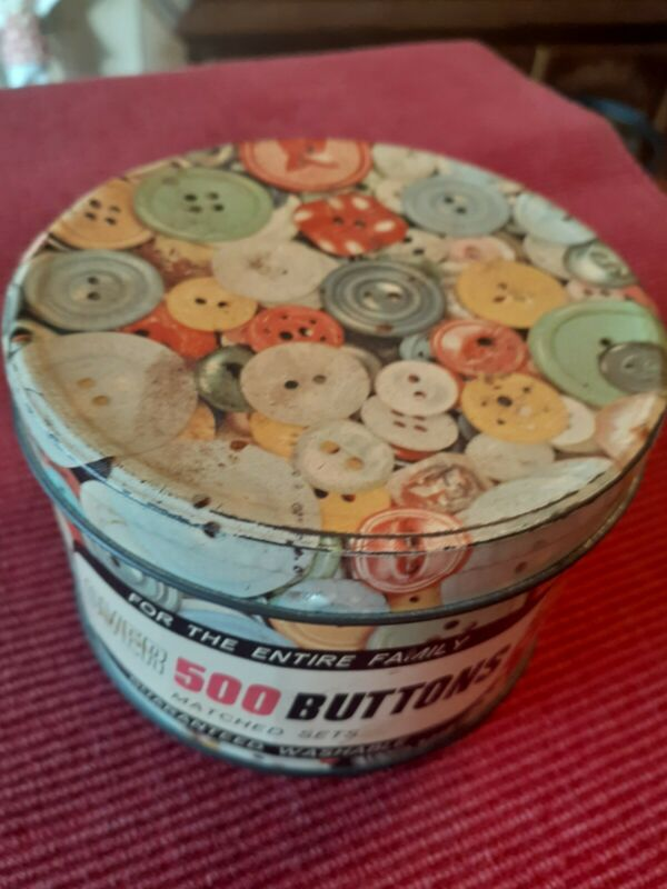 Vintage button tin with buttons
