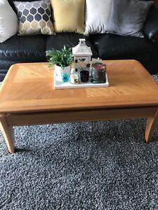 Coffee table with 2 end tables solid oak.  Table top rises