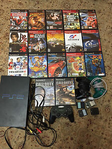 PlayStation 2 and 17 games and 3 controllers
