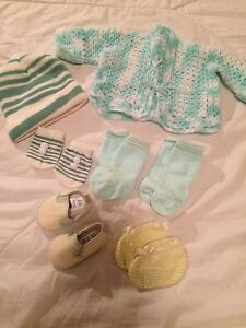 New baby sweater, hat, mitts and socks