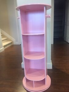 Pink bookcase and mirror