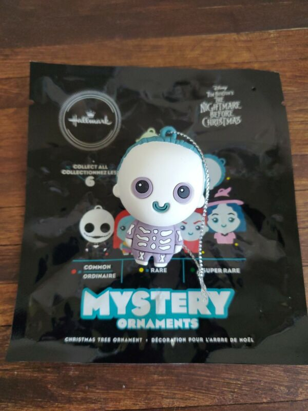 """NIGHTMARE BEFORE CHRISTMAS Hallmark Mystery Ornaments 2"""" Barrel - open package"""