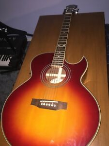acoustic guitar with electric plug in and hard case