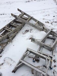 Lot of aluminum step ladders and benches