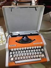 """Olympia """"Traveller de Luxe"""" Typewriter - Orange and White1970s Pagewood Botany Bay Area Preview"""