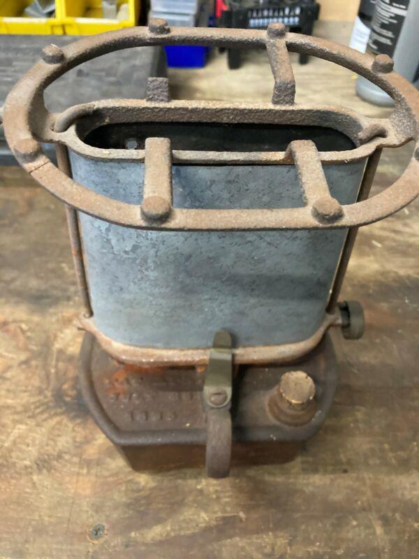 antique sad iron heater