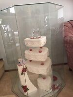 Red accent artificial wedding cake