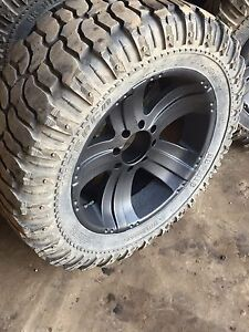 "37x13.5R22LT Interco SS-M16 on 22"" 8 bolt American racing rims"