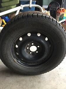 Set of 4 almost new winter tires on rims