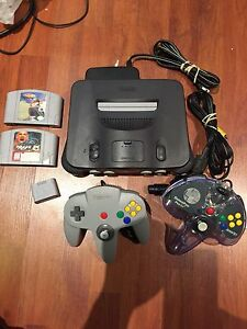 Nintendo 64 system with 2 controllers and 2 games