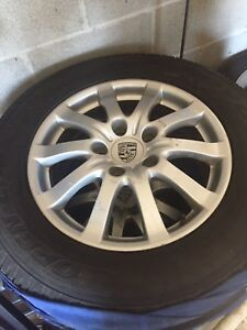 235/65 R17 Toyo Open Country A/T tires on Porsche Cayenne Rims