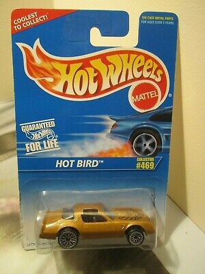 Hot Wheels 1:64 1996 Blue Card Collector # 469 Hot Bird gold with hood tampo