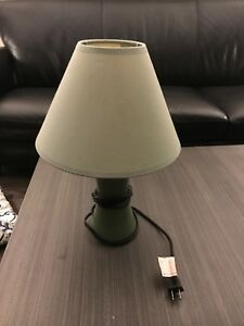 Single, small green table lamp