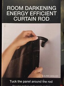 Room darkening curtain rods