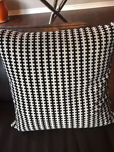 Pair of IKEA accent cushions.