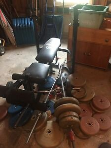Assorted weights bars and a bench